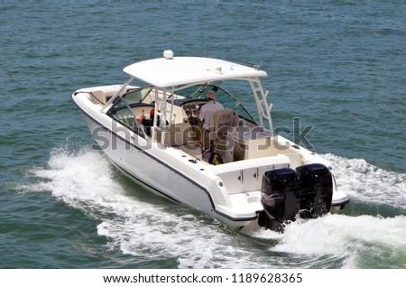 Sport fishing boat cruising on the Florida Intra-Coastal Waterway