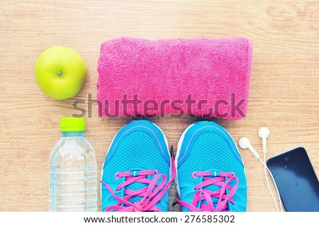 sport shoes and water with set ...