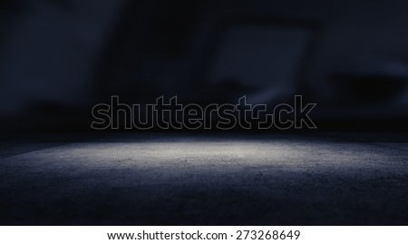 Spotlight on concrete floor.