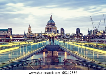 St Paul's Cathedral and Millennium Bridge at night.