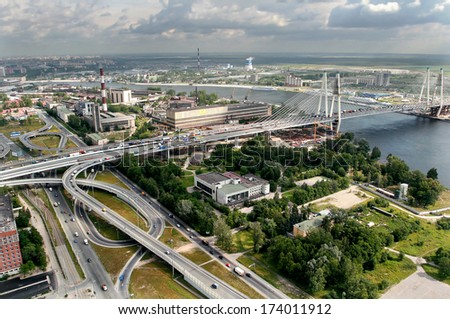 ST-PETERSBURG, RUSSIA - JULY 19, 2007:  Road interchange Ring Road and Avenue Obukhovskoy Oborony before  bridge Bolshoi Obuhovsky. Bridge is under construction second part. Bridge over the River #174011912