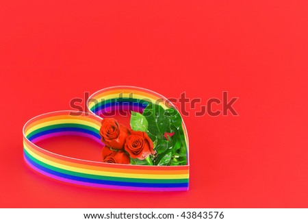 St. Valentine Day. Single heart, paint of a six-colour gay flag on red background