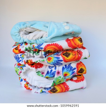 Stack of reusable diapers #1059962591