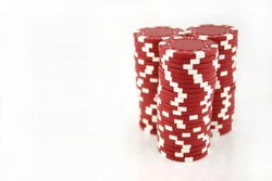 3 stacks of red casino chips isolated on a white background