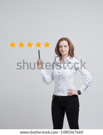5 star rating or ranking, benchmarking concept on grey background. Woman assesses service, hotel or restaurant #1480367660