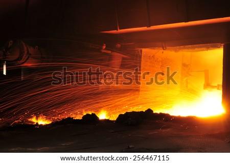 Steel blast furnace taphole spewed molten iron Stock fotó ©