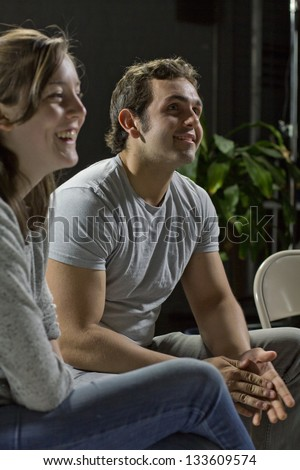 12 step support group members smiling - stock photo