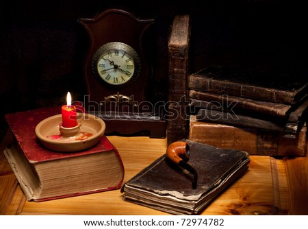 still life with old books, clock, candle and pipe