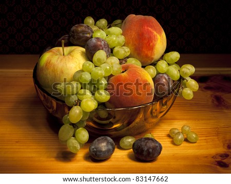 Still life with peaches, grapes, plums and apples