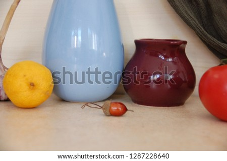 Still life with vases and lemon. #1287228640