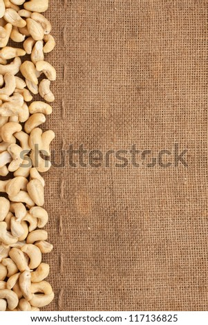 Stitching and sewing cashew lying on sackcloth can use as background