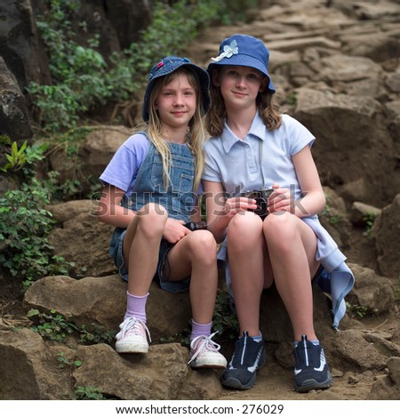 """STOCK - Portrait of two young girls sitting on rocks, Kauai, Molokai, Hawaii, February 2004 (Keith Levit)"""