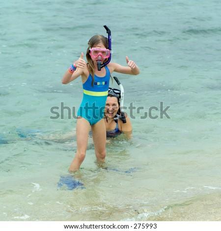 """STOCK - Two young girls wearing snorkels in the sea, Kauai, Molokai, Hawaii, February 2004 (Keith Levit)"""
