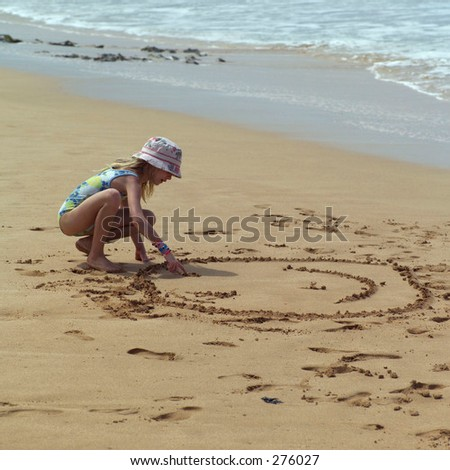 """STOCK - Young girl making designs in the sand on a beach, Kauai, Molokai, Hawaii, February 2004 (Keith Levit)"""