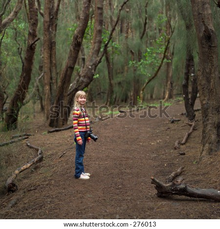 """STOCK - Young girl standing in the woods, Kauai, Molokai, Hawaii, February 2004 (Keith Levit)"""