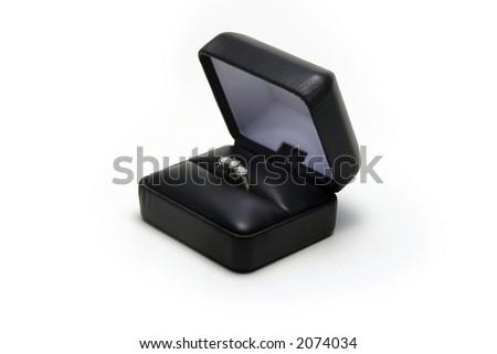 3 stone diamond ring in a jewelry box
