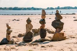 4 stone figures on the beach