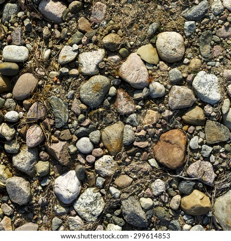 Stones On Ground Surface Texture Background/ Stones And Ground