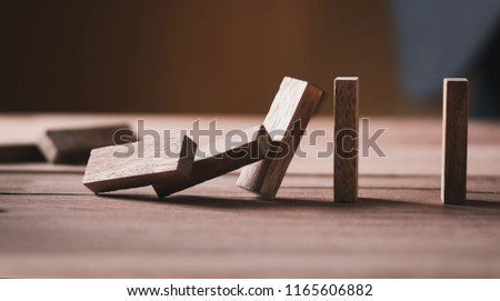 stopping risk the wooden blocks from falling