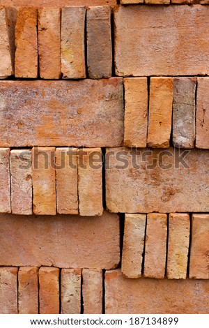 Store of bricks ready for building or sale. Construction materials and outdoor storage. Abstract background.