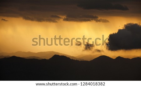 Storm approaching, view over mountains. Natural frame of clouds and mountains