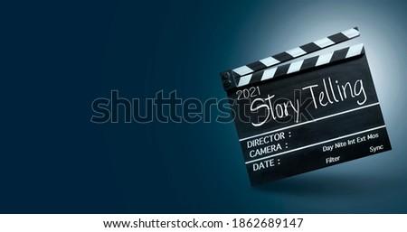 2021 story telling.Text title on film slate. Сток-фото ©