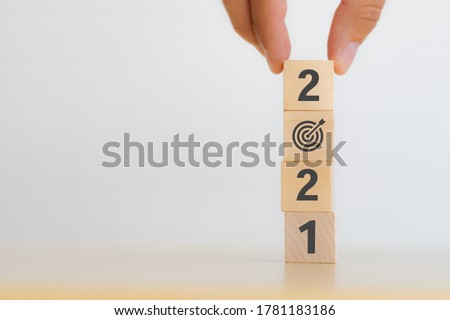 2021 strategy business growth concept. businessman hand flip wooden cubes from new year 2021