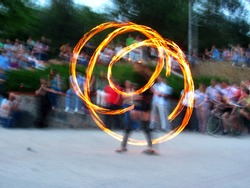 street fire show - photo with hands on a long exposure in the evening - beautiful fire tracks