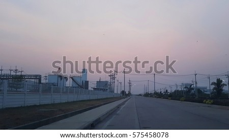 street road   factory in industrial estate with  sunset sky background    #575458078