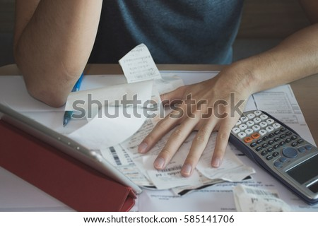 Stressed man shocked with amount to be paid for electricity,financial problem Stock photo ©