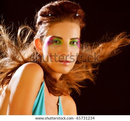 Studio shot of a young, beautiful, blond, fashionable woman #65731234