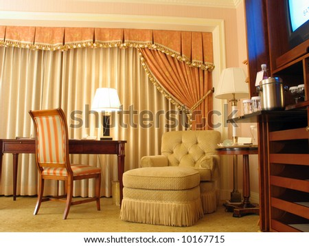 Study room with table chair lamp and curtain