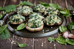 Stuffed portobello mushrooms. Mushrooms stuffed with spinach, onion, and garlic, with mozzarella cheese. Delicious and healthy snack.