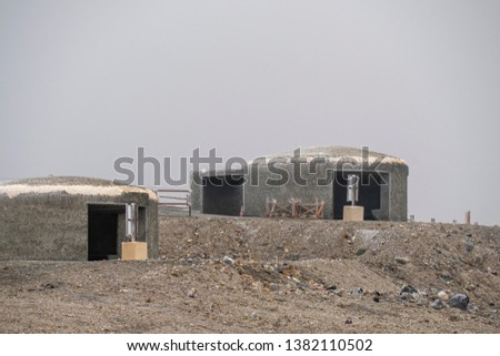 Sturdy volcano shelters on Mountain Aso #1382110502