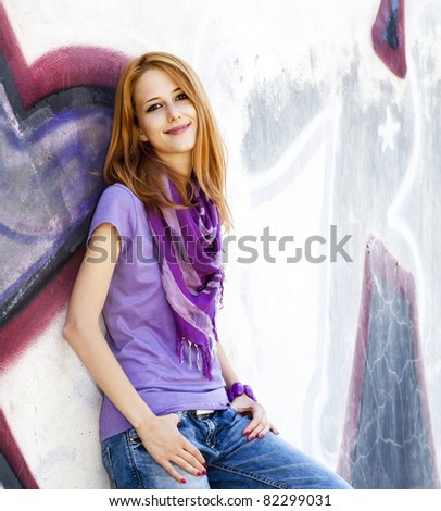 Style girl near graffiti wall.