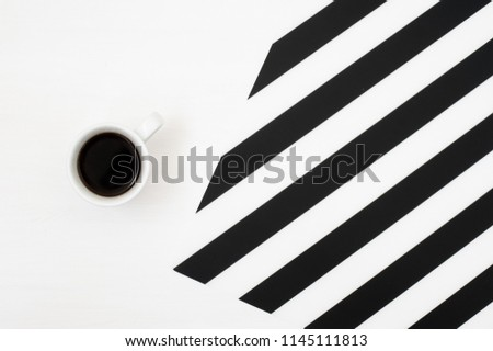 Stylish minimalistic with cup of coffee isolated on striped black and white background. Flat lay style Top view.  #1145111813