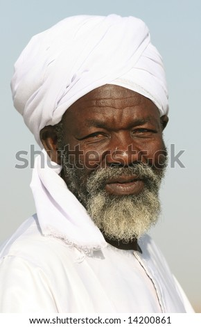 SUDAN - UNKNOWN: An older Sudanese man poses for a portrait in this undated image takenin in the Republic of Sudan. - stock photo