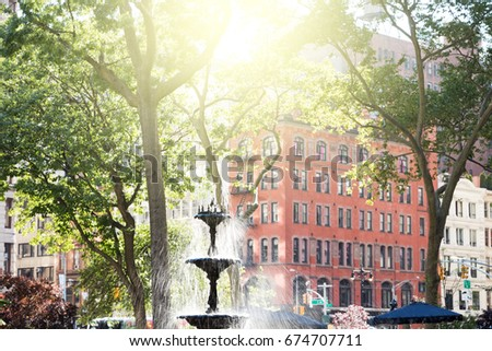 Summer scene with fountain and historic buildings in Madison Square Park in Manhattan, New York City NYC #674707711