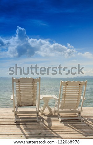 Summer white wood  beach chair with blue sky background
