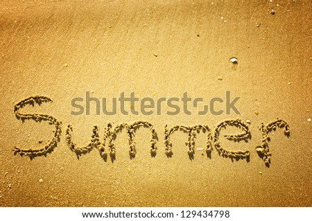 """""""Summer"""" written in the sand on the beach"""