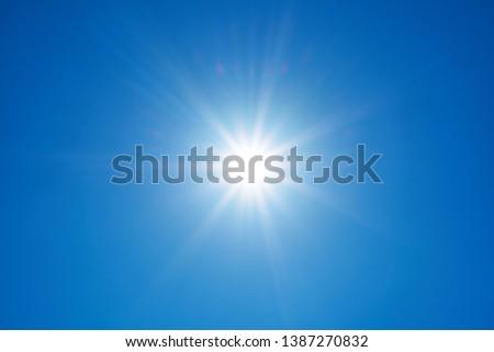 Sun on a background of blue sky                               #1387270832