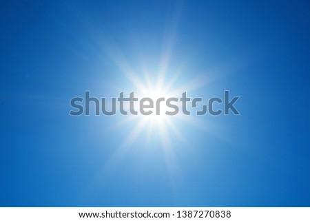 Sun on a background of blue sky                               #1387270838