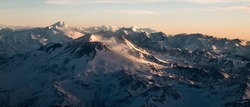 Sunrise in the Andes mountain range and Aconcagua protruding to the left on the horizon