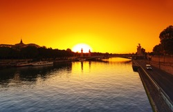 Sunrise on Seine river and left bank expressway of Paris