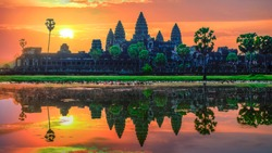 """Sunrise view of popular tourist attraction ancient temple complex Angkor Wat with reflected in lake Siem Reap, Cambodia."