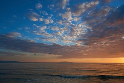 sunset over the sea in the Tuscan Maremma