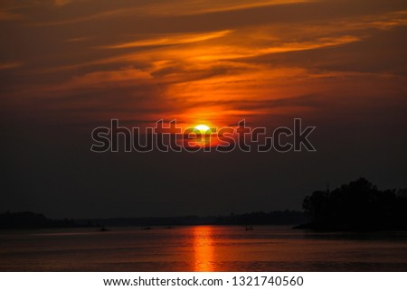 Sunset sky stratosphere background with rivers,Orange sunset sky stratosphere background with rivers. #1321740560