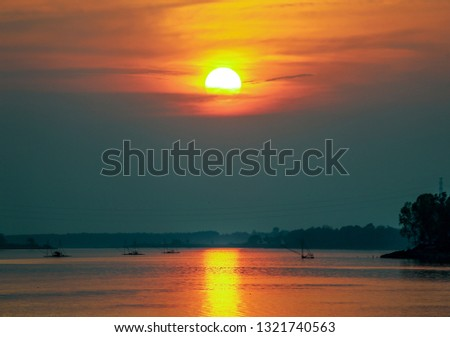 Sunset sky stratosphere background with rivers,Orange sunset sky stratosphere background with rivers. #1321740563