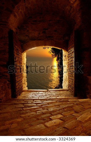 Sunset through the old castle on Mount Athos, Greece