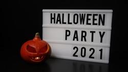 Super cool Halloween pumpkin with message on lightbox. Halloween Party 2021.
